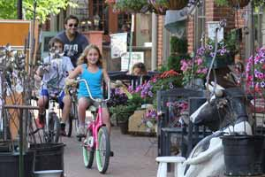 An images of two kids and an adult riding bicycles in Roscoe Village