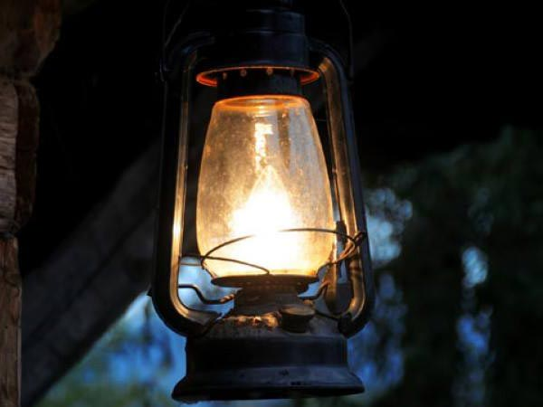 A decorative image of an old lamp intended to signify a dark night